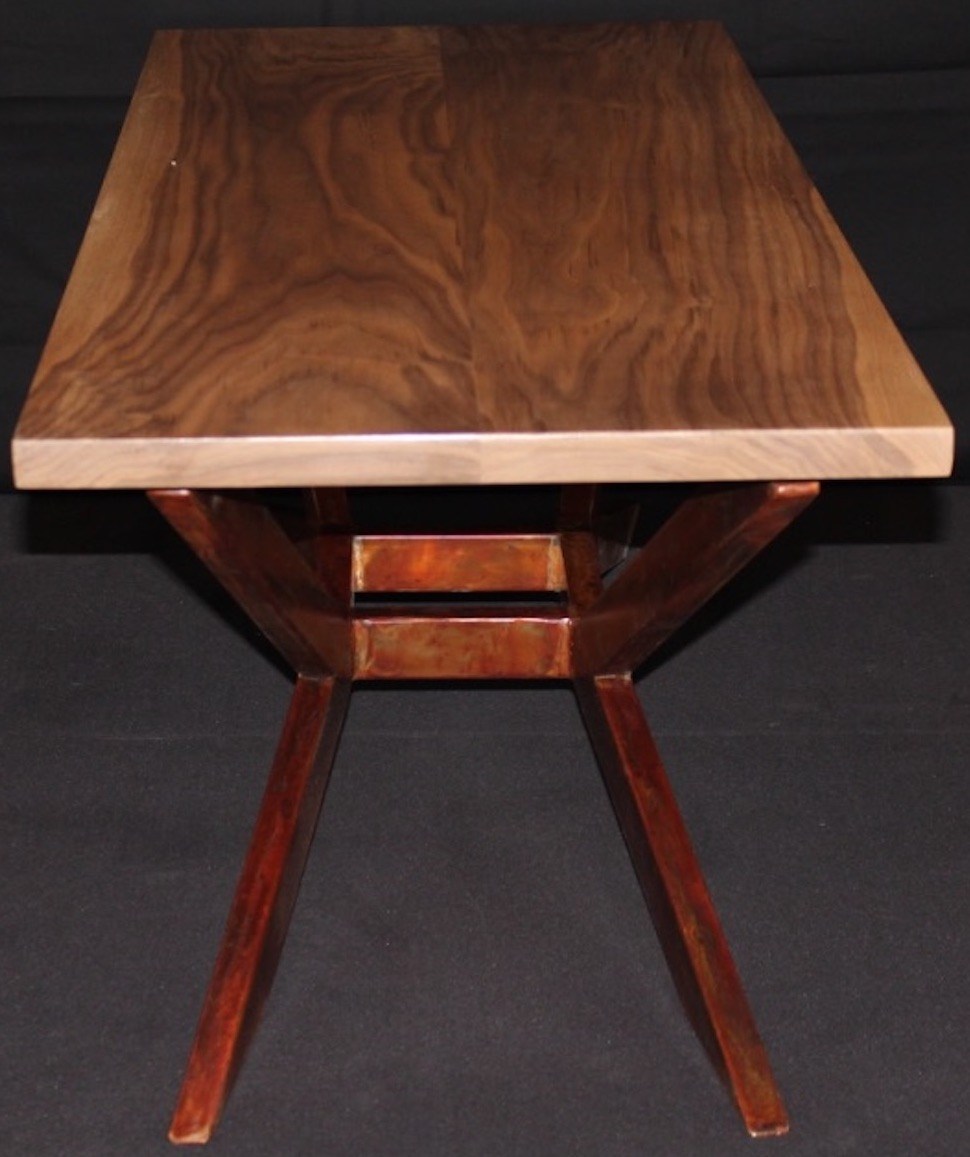 Custom furniture measuring a plant of wood with pencil and ruler